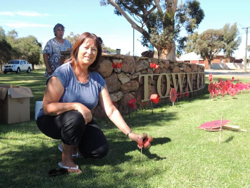 Anita Venner plants her poppy
